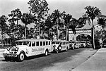 Line of Buses Traveling Through Entrance, 1924