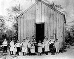 Portrait of First Class in Front of First Schoolhouse, 1889