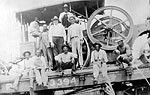 Road Equipment and Workers on Florida East Coast Railroad Flat Car, 192-