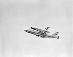 View of the Space Shuttle Discovery Being Flown Over the Capital City, Tallahassee, 1992