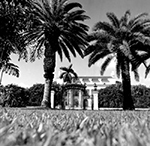 Distant View of the Flagler Museum Behind a Gate, Palm Beach Florida, 1975